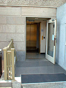 Photo of a lower entrace door giving access to a new elevator in the Dept of Agriculture South Building