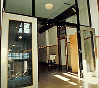 Glass partition in a former school stair hall
