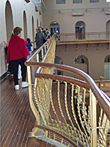 Compatible new painted metal railing inserted on the innerside of the historic railing