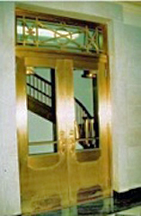 closed stair doors retrofitted with rated glass for fire and smoke separation