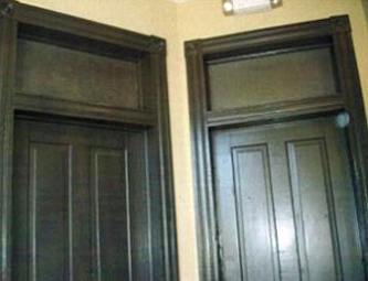 Two door interior doors with drywall behind the transoms