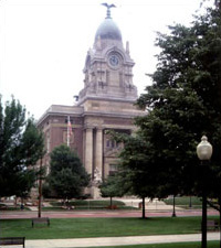 landmark building with pillars, a clock tower with a cupola and eagle on top
