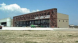 Photo of aircraft maintenance hangar with header truss roof framing system