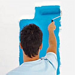 stock photo of a man using a paint roller