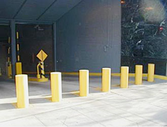 seven yellow bollards outside a security point