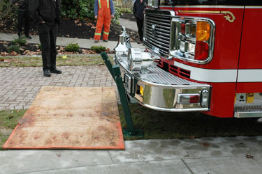 three collapsible by apparatus bumper force bollards with a fire truck knocking into them