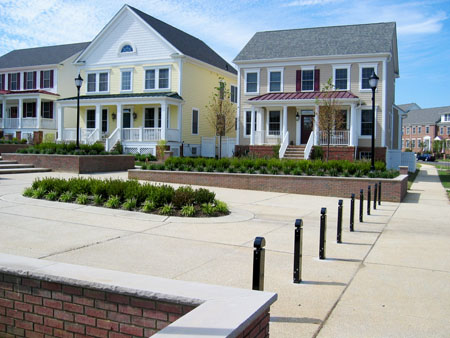 residential neighborhood with bollards lining the entry to a central courtyard