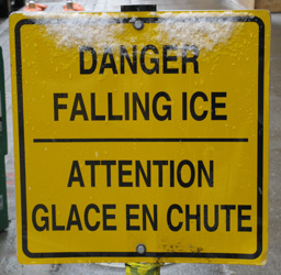 Yellow danger sign stating-Danger Falling Ice