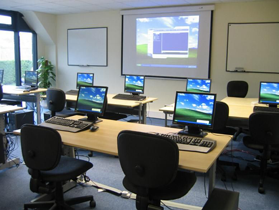 A photo displaying the space in a training room with individual learning stations.