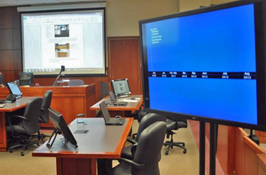 Using overhead screens and electronics in a courtroom