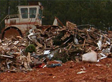 Large pile of debris at a construction and dmolition landfill cell
