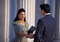 Photo of woman shaking hands with man