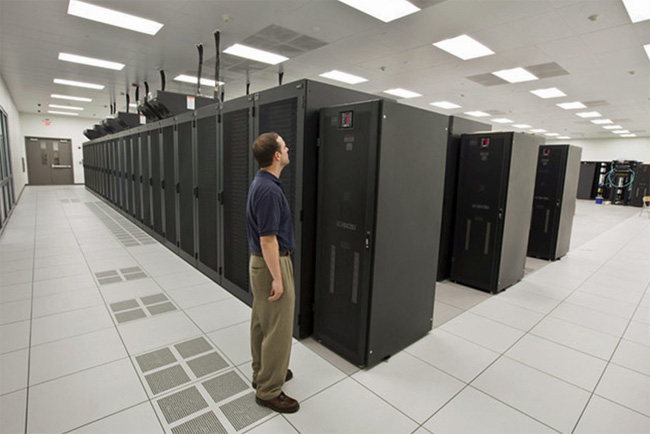 Man standing in server room at Emerson Data Center