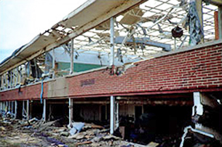 Extensive damage to an office building's curtain wall and interior during the F1/F2 Fort Worth Tornado