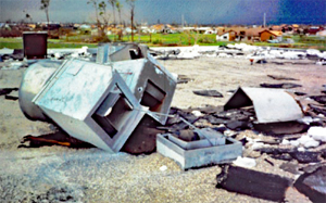 Rooftop mechanical equipment that has blown over leaving a hole through which rain water enters the building