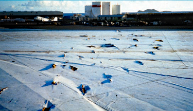 Photo of a fully adhered single-ply membrane struck by a large number of missiles during a hurricane