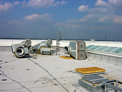 Dislodged/damaged rooftop HVAC equipment post-Hurricane Katrina
