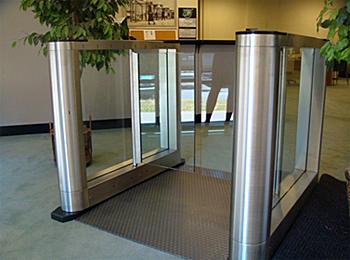Free-standing, half-height turnstile installation utilizing a drop in floor mounting panel.