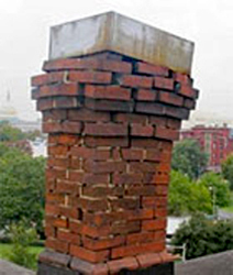 chimney with deteriorated mortar joints showing vibration damage after an earthquake