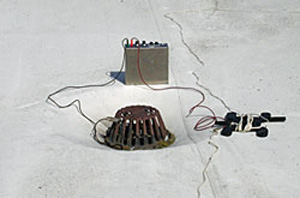 Photo 1 showing battery and equipment used to conduct the low voltage test