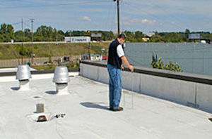 Photo 2 showing worker conducting the low voltage test on a rooftop