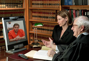 Lawyer and judge speaking to defendant via the Internet