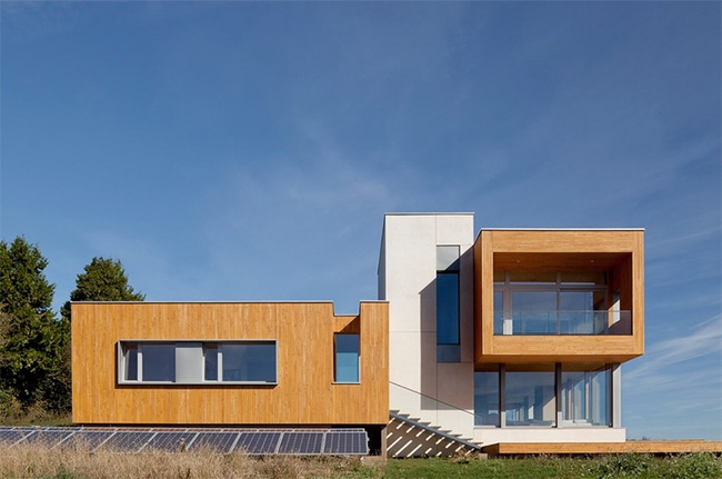 exterior of the Karuna House, Portland Oregon, showing the strength of the geometry and the PV array in the foreground