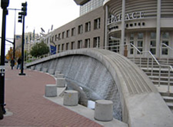 A waterwall structure and bollards at the terminus of a