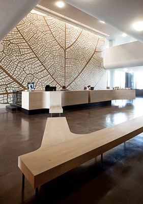 lobby featuring large-scale artwork, high-end materials and finishes, taking advantage of the large volume of the space