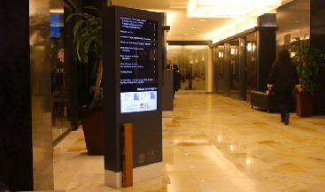 government building lobby featuring digital signage