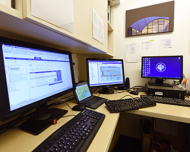 Computer monitors showing how a building and its systems can be managed