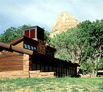 Photo of visitor center at Zion National Park showing downdraft cooling tower with evaporative media at the top, and exhaust through high clerestory windows