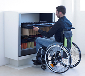 man in wheelchair with universal office storage - filing cabinet