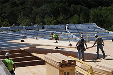 cross-laminated timber roof panel being installed