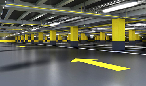 Basement parking garage with brightly painted directional arrows and columns
