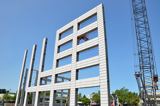 Precast parking components used in structured parking garage construction