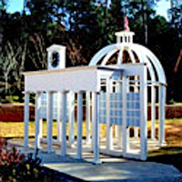 Custom-designed wooden playground structure of an abstract replica of Alabama's state capital