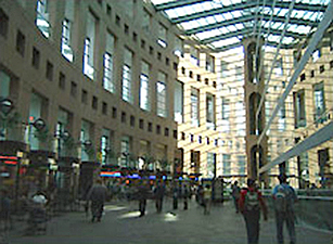 A plaza with an overhead archway system.