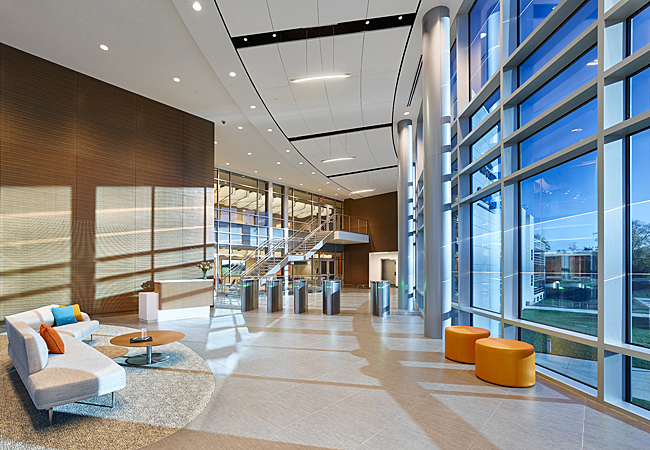 Lobby area with glazing to exterior providing ample light and views at the Saint Gobain CertainTeed North American Headquarters