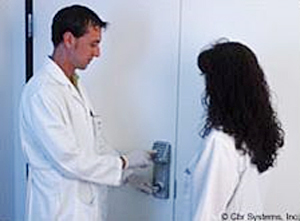 laboratory technicians using a swipe reader to enter restricted area