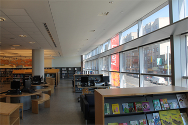 Curtain wall and a light shelf in a second-floor library space