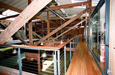 Interior view of trusses and catwalk on conversion of a former manufacturing building