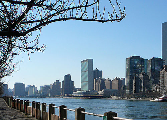 View of the United Nations Headquarters in the background across the East River.