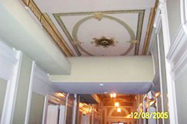 highly ornamented ceiling trim with utility soffits and ducts installed over it which do not meet the Sectretary's standards