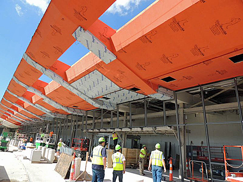WrapShield SA (in orange) being installed at Cleveland Hopkins Airport