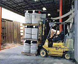 Photo of a warehouse worker using the forklift